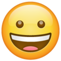 grinning face emoji on whatsapp