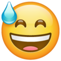 grinning face with sweat emoji on whatsapp